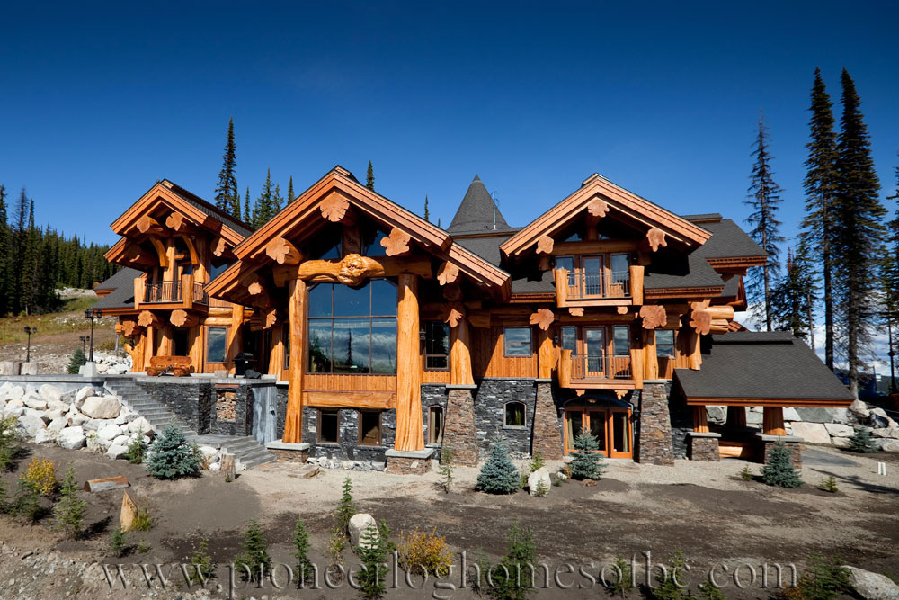Big white log home custom built log homes pioneer log for Large log cabin homes