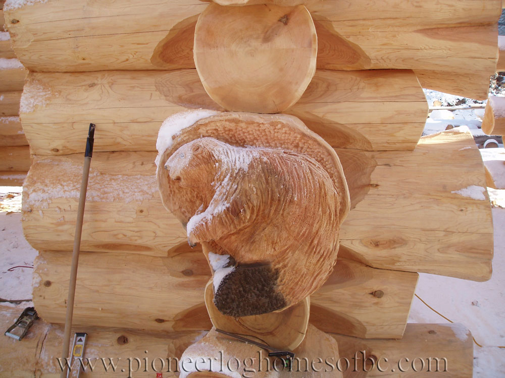 Custom wood carvings and sculptures pioneer log homes of bc